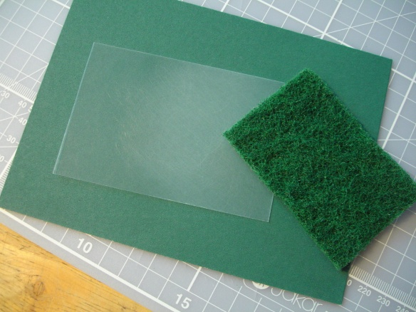 Matting acetate with a kitchen scourer