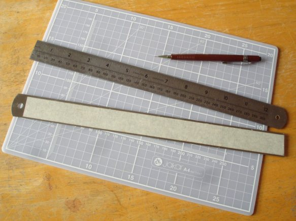 masking tape on metal ruler