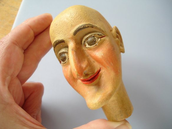 carved puppet head