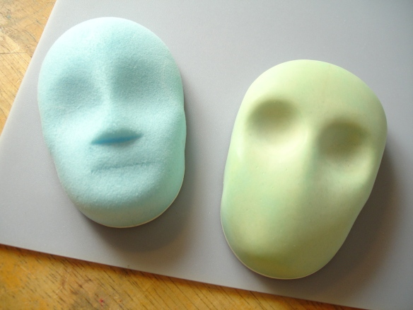 Uncoated and coated styrofoam 'heads'
