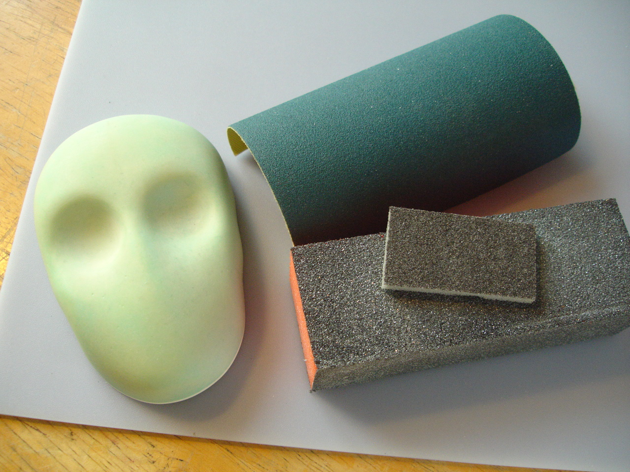 Foam-backed and cloth-backed sanding materials