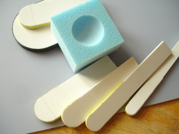 Custom sanding tools for making concave shapes in foam