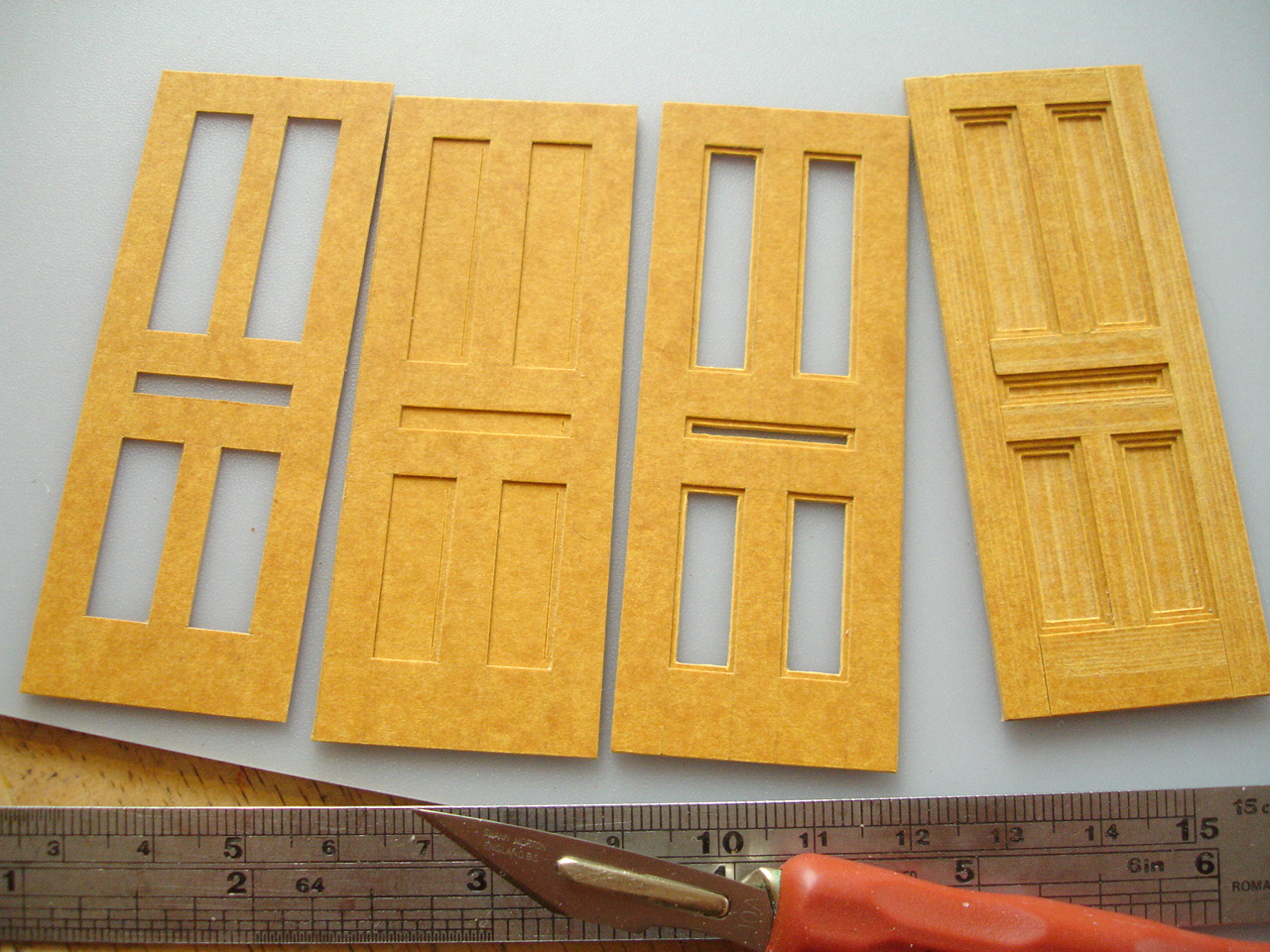 stages in making a panelled door in stencil card
