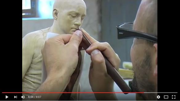 Sculptor Guy Reid making 'Andrew' in limewood