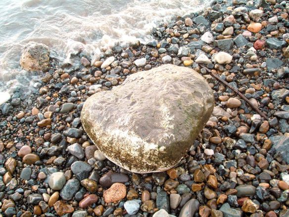 large boulder at the water's edge, Thames Foreshore, Rotherhithe