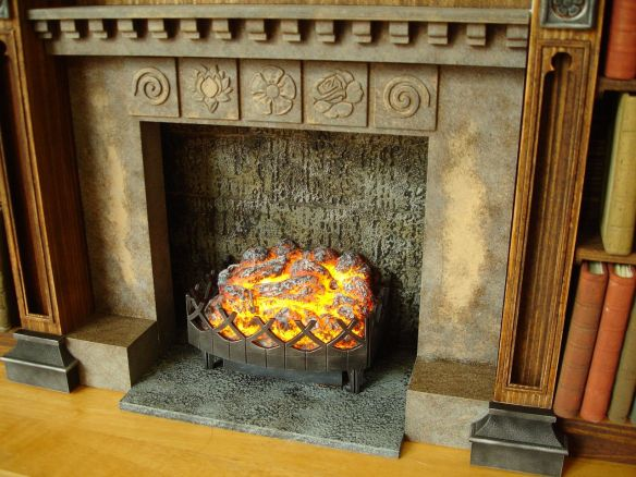 David Neat, props for stop-motion animation, working fireplace effect, painting unfinished